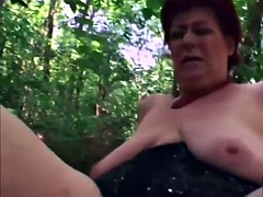 a nasty redhead mature slut masturbates and gets banged in the forest