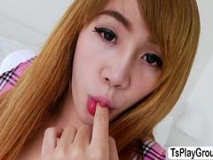 Redhead Asian ladyboy Grace enjoys solo masturbation