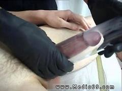 Doctor using shiny black gloves fingers his twink patient
