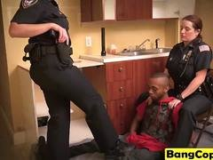 Black stud gets forced into banging busty cops