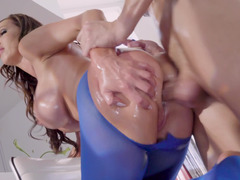 A chick with huge tits and a wet oiled up ass is getting fucked