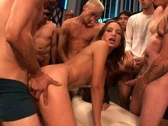 A gorgeous women is getting penetrated by a group of men today