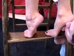 Foot worship on a ladder