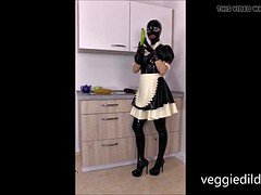 Latex Maid enjoys veggiedildos in pussy and ass