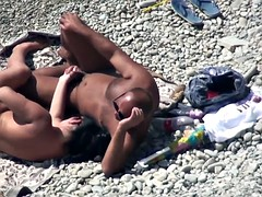 naked people having sex on the beach