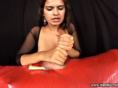 Sadistic mistress milks cum from mummy during femdom handjo