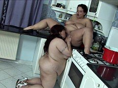 Two fat sluts with huge tits fuck on the kitchen floor