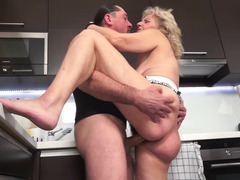 A granny with a hairy cunt is getting cum all over her plump body