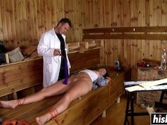 A kinky babe gets tied up and scored hard by a stud with a hulking cock in sauna
