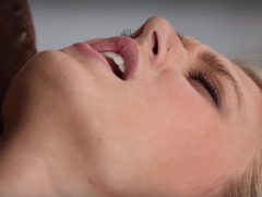 Blonde with natural tits is teasing her cunt lips close up to us