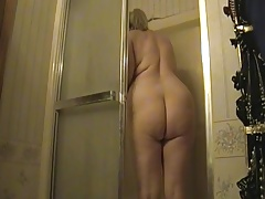 Kim nude in the shower.