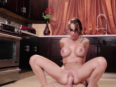 A busty slut is getting her pussy opened up in the kitchen