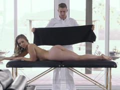 A blonde is caught naked on the massage table as she is getting touched