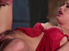 A blonde with hair on her pussy is penetrated in the dungeon