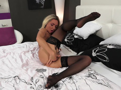 Blonde that loves to jack off is using her large sexy toy on bed