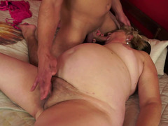 A fat and nasty granny is riding a dude on the bed and she is moaning
