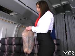 Sexy stewardess in pantyhose seduced by a pilot in airplane