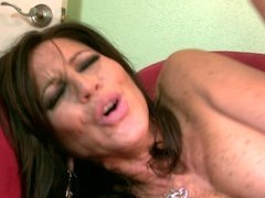 A fine mature Latina with big boobs is licking a big hard dick
