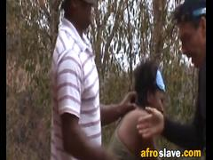 Afircan slut getting tied up and abused by two fellows