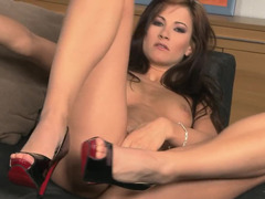 A hot thing with sexy high heels is giving herself an orgasm