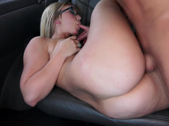 A big booty gets exposed in the back of the bang bus in this scene