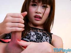 Thai ladyboy teasing and jerking off her cock in bed