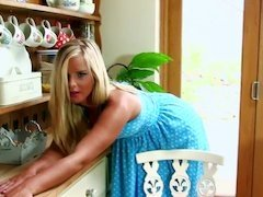 A blonde removes her dress so she could play with herself well