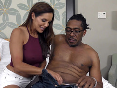 A black dude is sticking his dick into a hot bimbo with large tits