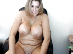 Good-looking chubby girl rubs her tits