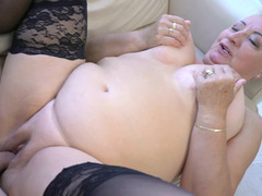 A fat nasty old woman has her large tits fucked well today