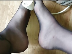 Footplay in Feinstrumpfhose