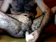 Hairy guy and his dildo