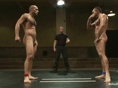 Two muscular gays bang after having a hot fight on a ring