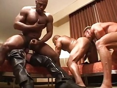 Interracial body builders copulate hard in orgy.