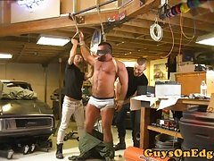 BDSM sub bounded to car and edged by maledoms