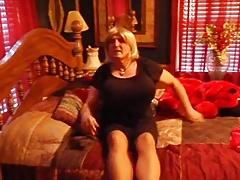 Busty crossdresser in black dress