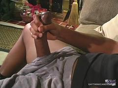 An black stud with an monster cock is teasing and jerking it off