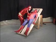 Superhero attired studs sucking cock
