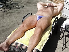 Sunning in purple bikini