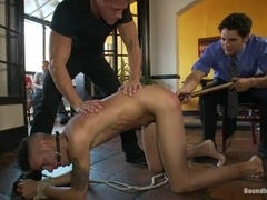 Nico enjoys having a stick in his ass in a group gay BDSM scene