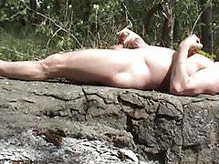 Nude at the lake close-up