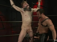Noah Brooks gets tortured and fucked by Spencer Reed in BDSM scene