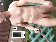 Naked in garden with selfie stick and piss