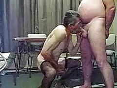 Older man sucking another man