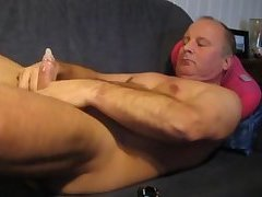 Meaty mature slaps on a condom before jerking off
