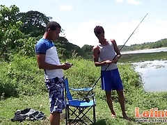 Fishing turns into oral fun for two Latino twinks