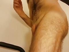 Athlete man running a treadmill nude (slow motion)