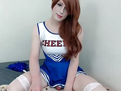 Cute Cheerleader Crossdresser in Stockings