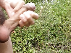 Quick wank 7 cumming hard shaved uncut cock in fields