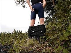 Wanking outside in bike shorts